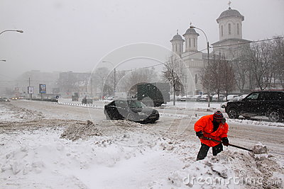 Man working at snow removal Editorial Stock Photo