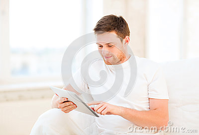 Man working with tablet pc at home
