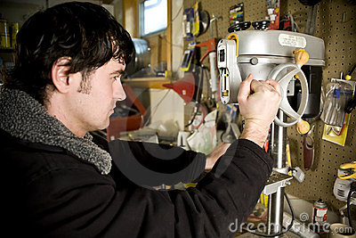 Man in workshop using drill