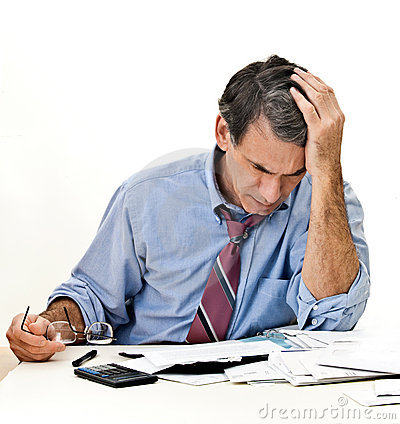 Man Worried about Bills and Bankruptcy