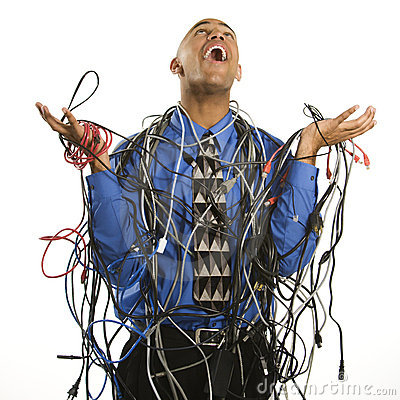 Free Man Wrapped In Cables. Stock Photography - 2425862