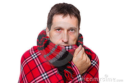 Man wrapped in a warm blanket