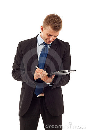 Man writing on his notepad