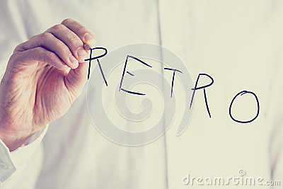 Man writing the word Retro on a virtual screen
