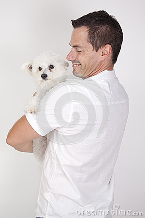 Man with cute pet dog
