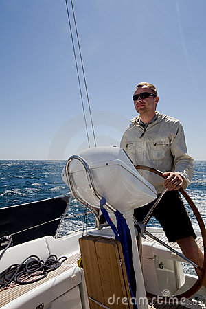Man at yacht Helm
