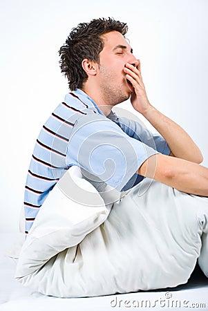Man yawning and preparing for sleep