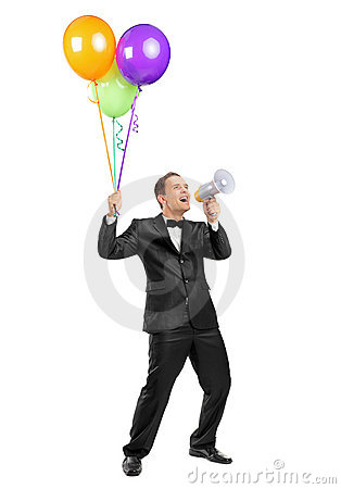 Man yelling throw a megaphone and holding balloons