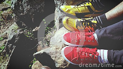 Man In Yellow And Black Low Top Sneakers Beside Red And White Low Top Sneakers Free Public Domain Cc0 Image