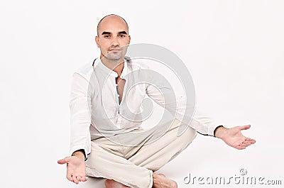 Man in yoga position.