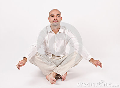 Man in yoga position.