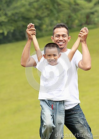 Man and young boy playing