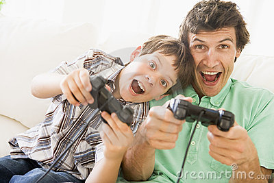 Man and young boy with video game controllers