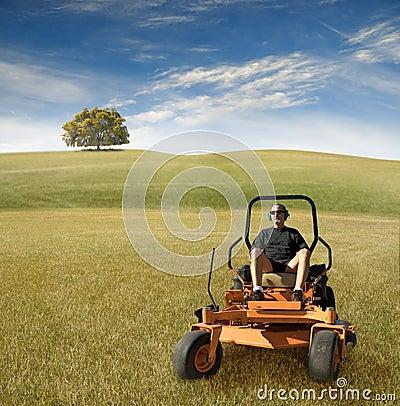 Man on zero turn lawnmower
