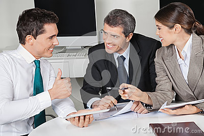 Manager in business meeting holding