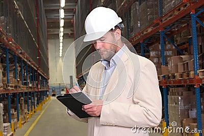 Manager checking stocks