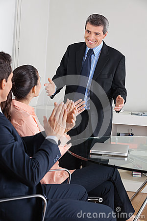 Manager clapping hands for