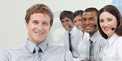Manager and his team smiling at the camera