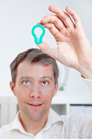 Manager holding lightbulb over head