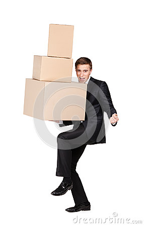 Manager holding pile of cardboard boxes