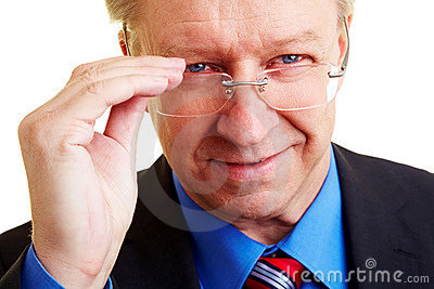 Manager looking over his glasses