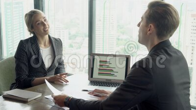 Manager meeting looking report statistic with chart and graph on screen laptop computer about finance with secretary. Businesswoman talking and planning stock footage