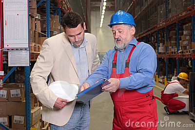Manager+older worker+warehouse