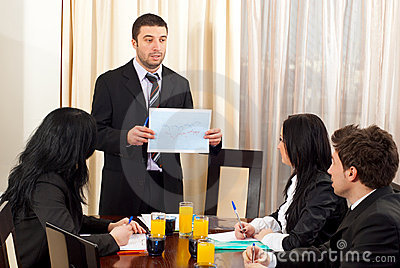 Manager showing financial graph at meeting