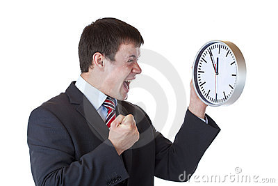 Manager under time pressure clenches his fist