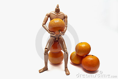 Mandarins and plastic doll