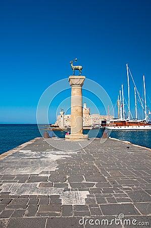Mandraki harbor and bronze deer statues, Greece