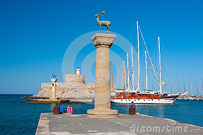 Mandraki harbor and bronze deer statues, Greece Editorial Stock Photo