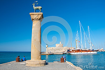 Mandraki harbor and bronze deer statues, Greece Editorial Stock Image