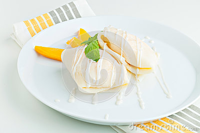 Thai style tropical dessert crepes filled with fresh mango and sticky ...
