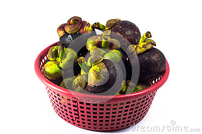 Mangosteen in red basket  isolated