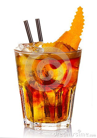 Manhatten alcohol cocktail with orange fruit slices isolated