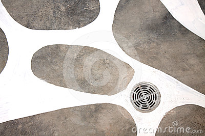 A manhole cover on cement background