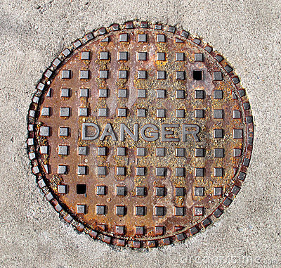 Free Manhole Cover Saying Danger Isolated Stock Photos - 23843363