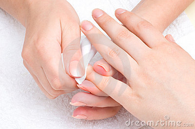 Manicure applying - wiping the moisturizer
