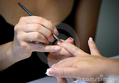 Manicure making female hands covering of enamel