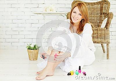 Manicure and pedicure - beautiful woman