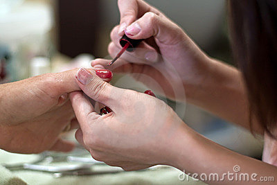 Manicure with red fingernail polish