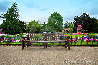 Manicured flower garden with a wooden bench