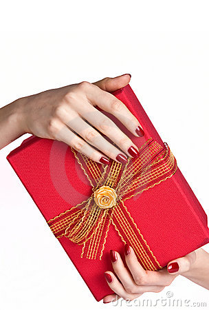 Manicured hands holding present box