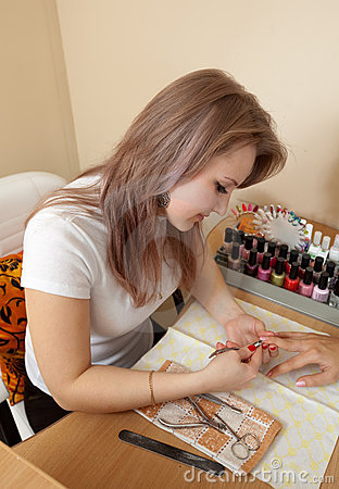 Manicurist working with   nails