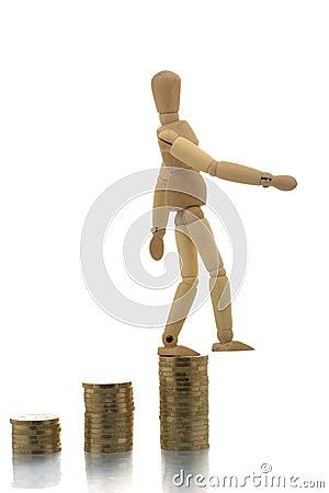 Manikin falling off coin piles