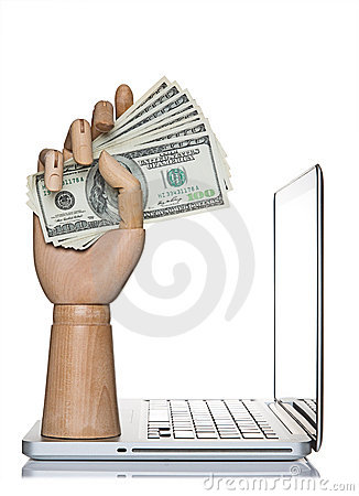 Manikin hand holding money on a computer laptop