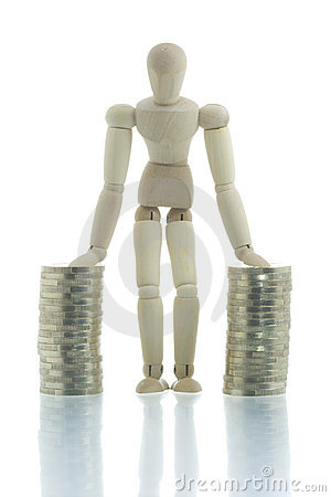 Free Manikin Standing Between Two Coin Piles Stock Image - 4267171