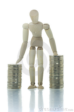 Free Manikin Standing Between Two Coin Piles Stock Photography - 4267172