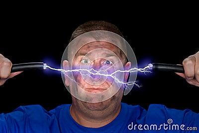 Mann und elektrischer Lichtbogen
